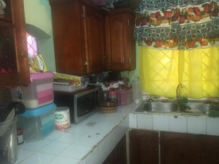 2 BED 1 BATH HOUSE FOR SALE IN LILLIPUT, ST. JAMES, JAMAICA