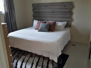 1 BED 2 BATH APARTMENT FOR SALE IN CONDOMINIUMS AT THE DRUMBLAIR, KINGSTON / ST. ANDREW, JAMAICA